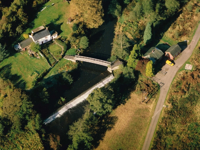 Arial view of Crumpwood Weir and cottage, possibly 1980s