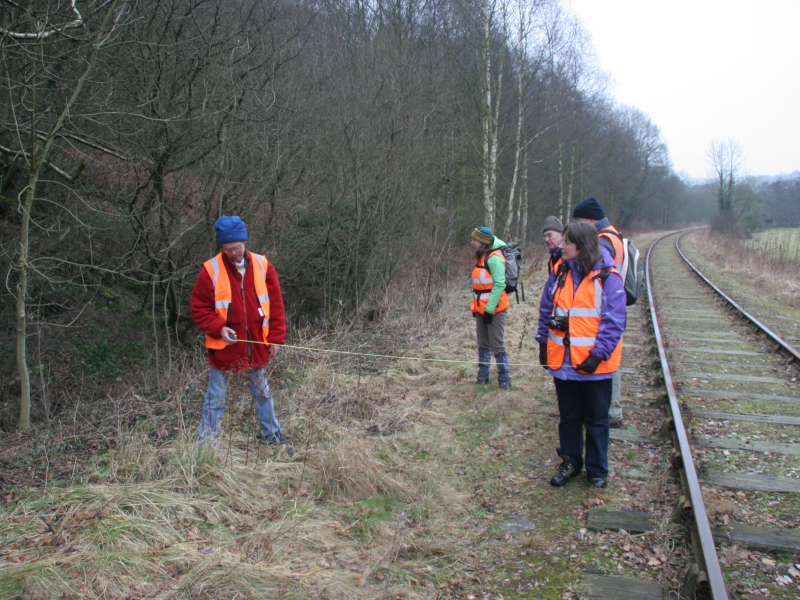 Surveying the line of the Uttoxeter Canal next to the railway, January 2011